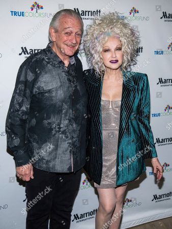 """Cyndi Lauper, Charlie Musselwhite. Charlie Musselwhite and Cyndi Lauper pose backstage at the 8th Annual """"Home for the Holidays"""" benefit concert at the Beacon Theatre, in New York"""