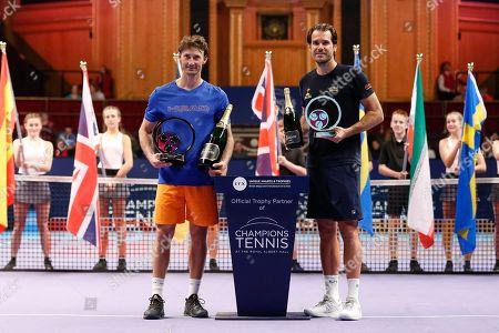 CHAMPION Juan Carlos Ferrero winner of the Men's Singles Final Champions Tennis match, Runner up Tommy Haas, at the Royal Albert Hall, London.