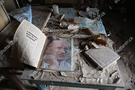 Stock Image of Original  life magazine from 1967 with a picture of the Israeli Defense Minister, Moshe Dayan is seen inside the Ethiopian church at Qasr al Yahud baptism site during a combined operation of the Israeli  sapper landmine  authority and the HALO Trust organization to demolish the mines around the churches of Qaser al Yahud baptism near the Jordan River, near the West Bank city of Jericho, 09 December  2018. Israel National Mine Action Authority (INMAA) under the Ministry of Defense, together with HALO Trust, an international mine clearance charity, are in ongoing operation to clear the Qasr al-Yahud Baptism Site of all residual mines and explosive remnants of the 1967 Six-Day War. The project will demine roughly one million square meters of land. Defense Ministry officials expect to find approximately three thousand targets, consisting of anti-personnel mines, anti-tank mines, and other explosive remnants of war. The site is home to eight different church denominations, and access to the church plots and surroundings has been restricted since the 1970s.