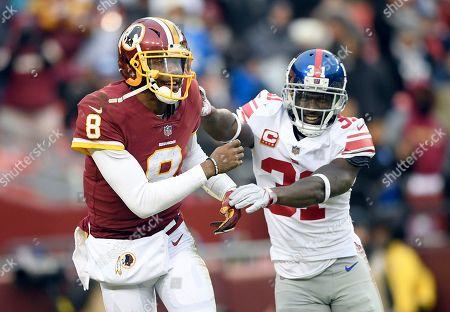 New York Giants defensive back Michael Thomas (31) smiles at Washington  Redskins quarterback Josh ... 2a1808ab1
