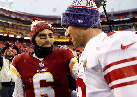 Mark Sanchez, Eli Manning. Washington Redskins quarterback Mark Sanchez (6) winks at New York Giants quarterback Eli Manning (10) as they talk after an NFL football game, in Landover, Md