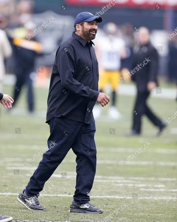 Former Pittsburgh Steelers running back Franco Harris walks on the field before an NFL football game between the Oakland Raiders and the Steelers in Oakland, Calif