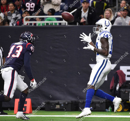 Indianapolis Colts wide receiver Zach Pascal (14) makes a touchdown catch as Houston Texans defensive back Shareece Wright (43) defends during the second half of an NFL football game, in Houston
