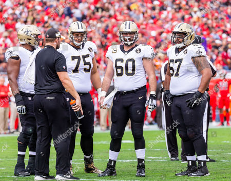 Stock Photo of New Orleans Saints offensive guard Andrus Peat (75), New Orleans Saints center Max Unger (60) and New Orleans Saints offensive guard Larry Warford (67) during the game between the New Orleans Saints and the Tampa Bay Buccaneers at Raymond James Stadium in Tampa, Florida. Saints win 28-14