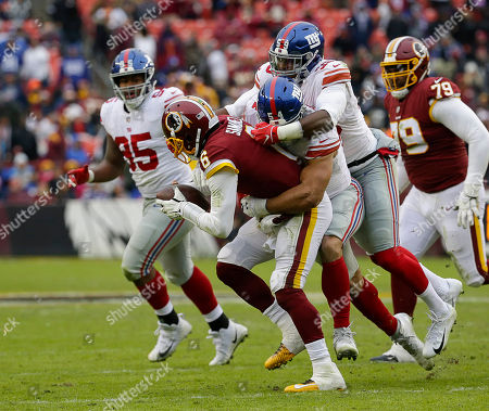 New York Giants LB #54 Olivier Vernon and New York Giants LB #59 Lorenzo Carter sack Washington Redskins QB #6 Mark Sanchez during a NFL football game between the Washington Redskins and the New York Giants at FedEx Field in Landover, MD