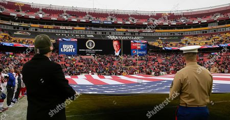 A moment of silence is held for President George H.W. Bush before a NFL football game between the Washington Redskins and the New York Giants at FedEx Field in Landover, MD