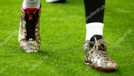 Arizona Cardinals wide receiver Larry Fitzgerald wears cleats honoring the late U.S. Sen. John McCain prior to an NFL football game against the Detroit Lions, in Glendale, Ariz