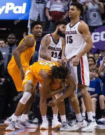 Gonzaga's Josh Perkins (13) and Brandon Clarke watch while Tennessee's Kyle Alexander, left, begins to celebrate as teammate Yves Pons (35) cradles a last second rebound during the second half of an NCAA college basketball game in Phoenix