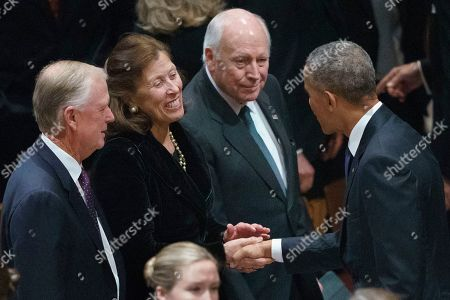 Former President Barack Obama, greets former Vice President Dan Quayle, and his wife Marilyn Quayle, and former Vice President Dick Cheney, before a State Funeral for former President George H.W. Bush at Washington National Cathedral in Washington