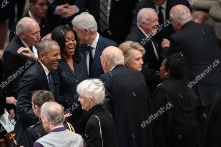 From left, former Vice President Dick Cheney, former President Barack Obama, Micelle Obama, former President Bill Clinton, former Secretary of State Hillary Clinton, and former President Jimmy Carter, mingle before a State Funeral for former President George H.W. Bush at Washington National Cathedral in Washington