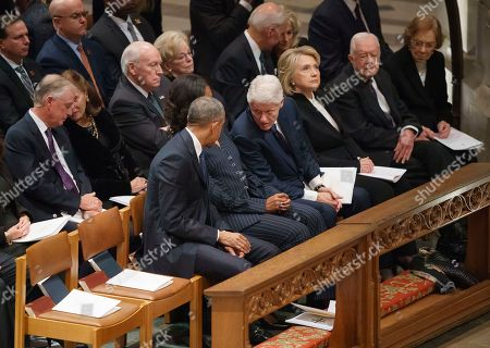 Former President Barack Obama, Michelle Obama, former President Bill Clinton, former Secretary of State Hillary Clinton, former President Jimmy Carter, and Rosalynn Carter, sit together before the start of the State Funeral of former President George H.W. Bush at the National Cathedral, in Washington. In the second row, form left, are former Vice President Dan Quayle, Marilyn Quayle, former Vice President Dick Cheney, Lynn Cheney, former Vice President Joe Biden and Jill Biden