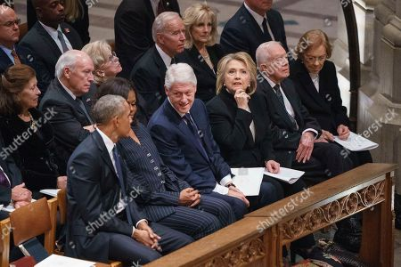 Former President Barack Obama, Michelle Obama, former President Bill Clinton, former Secretary of State Hillary Clinton, former President Jimmy Carter, and Rosalynn Carter, sit together before the start of the State Funeral of former President George H.W. Bush at the National Cathedral, in Washington. In the second row, form left, are Marilyn Quayle, former Vice President Dick Cheney, Lynn Cheney, former Vice President Joe Biden and Jill Biden