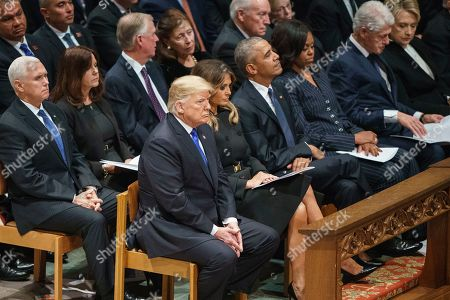 From Left, President Donald Trump, first lady Melania Trump, former President Barack Obama, Michelle Obama, former President Bill Clinton, and former Secretary of State Hillary Clinton, attend the State Funeral of former President George H.W. Bush at the National Cathedral, in Washington. In the second row from left are, Vice President Mike Pence, Karen Pence, former Vice President Dan Quayle, Marilyn Quayle, former Vice President Dick Cheney, and Lynne Cheney