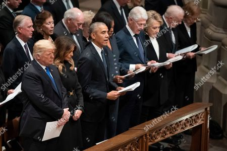 From left, President Donald Trump, first lady Melania Trump, former President Barack Obama, Michelle Obama, former President Bill Clinton, and former Secretary of State Hillary Clinton, former President Jimmy Carter, and Rosalynn Carter attend the State Funeral of former President George H.W. Bush at the National Cathedral, in Washington. In the second row from left are, former Vice President Dan Quayle, Marilyn Quayle, and former Vice President Dick Cheney