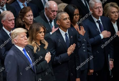 President Donald Trump, Melania Trump, former President Barack Obama, Michelle Obama, former President Bill Clinton, and former Secretary of State Hillary Clinton, stand during the State Funeral of former President George H.W. Bush at the National Cathedral, in Washington. In the second row are former Vice President Dan Quayle, and his wife Marilyn Quayle and former Vice President Dick Cheney