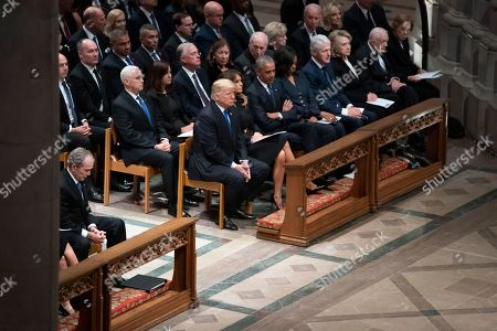 From Left, former President George W. Bush, President Donald Trump, first lady Melania Trump, former President Barack Obama, Michelle Obama, former President Bill Clinton, and former Secretary of State Hillary Clinton, former President Jimmy Carter, and Rosalynn Carter, attend the State Funeral of former President George H.W. Bush at the National Cathedral, in Washington. In the second row are Vice President Mike Pence, Karen Pence, former Vice President Dan Quayle, Marilyn Quayle, former Vice President Dick Cheney, Lynne Cheney, former Vice President Joe Biden and Jill Biden