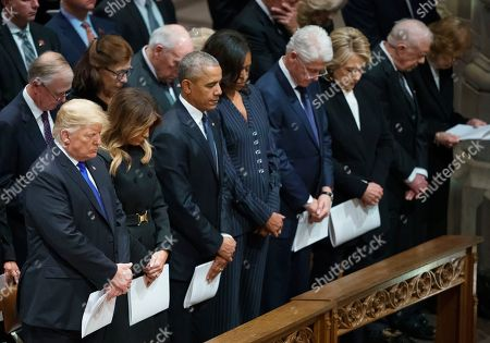President Donald Trump, Melania Trump, former President Barack Obama, Michelle Obama, former President Bill Clinton, and former Secretary of State Hillary Clinton, former President Jimmy Carter, and Rosalynn Carter, bow their heads during the State Funeral of former President George H.W. Bush at the National Cathedral, in Washington. In the second row are former Vice President Dan Quayle, and his wife Marilyn Quayle and former Vice President Dick Cheney
