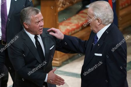 Stock Photo of Jordan's King Abdullah II and former Canadian prime minister Brian Mulroney greet each other after a State Funeral for former President George H.W. Bush at the National Cathedral, in Washington