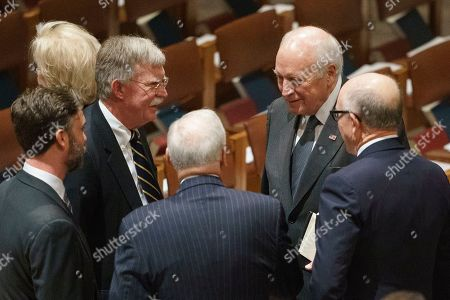 Former Vice President Dick Cheney, second from right, and National Security Adviser John Bolton, third from left, talk with other mourners before a State Funeral for former President George H.W. Bush at Washington National Cathedral in Washington
