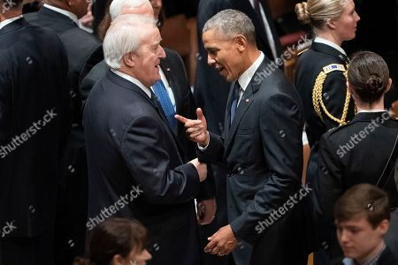 Former President Barack Obam, right, former Canadian prime minister Brian Mulroney talk before a State Funeral for former President George H.W. Bush at Washington National Cathedral in Washington