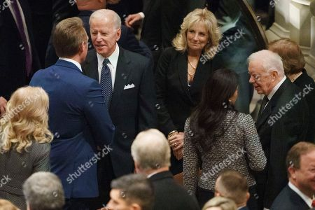 Stock Picture of Former Vice President Joe Biden and his wife Jill Biden talk with Sen. Jeff Flake, R-Ariz., left, as former President Jimmy Carter stands right, before a State Funeral for former President George H.W. Bush at Washington National Cathedral in Washington