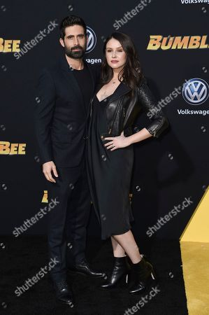 "Stephen Schneider, Jenn Proske. Stephen Schneider, left, and Jenn Proske, attend the LA premiere of ""Bumblebee"" at TCL Chinese Theatre, in Los Angeles"