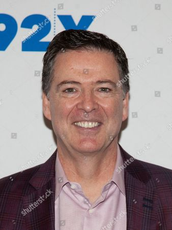 Former FBI Director James Comey poses backstage before his conversation with Nicolle Wallace at the 92nd Street Y, in New York