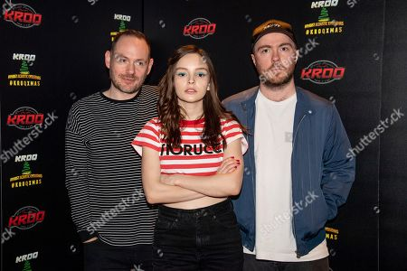 Iain Cook, Lauren Mayberry, Martin Doherty. Iain Cook, from left, Lauren Mayberry and Martin Doherty of CHVRCHES pose at the 2018 KROQ Absolut Almost Acoustic Christmas at The Forum, in Inglewood, Calif