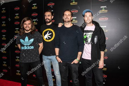 Stock Image of Chris Wood, Kyle J Simmons, Will Farquarson, Dan Smith. Chris Wood, from left, Kyle J Simmons, Will Farquarson and Dan Smith of Bastille pose at the 2018 KROQ Absolut Almost Acoustic Christmas at The Forum, in Inglewood, Calif