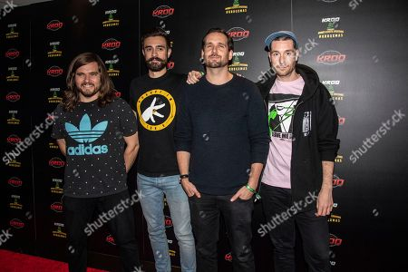 Chris Wood, Kyle J Simmons, Will Farquarson, Dan Smith. Chris Wood, from left, Kyle J Simmons, Will Farquarson and Dan Smith of Bastille pose at the 2018 KROQ Absolut Almost Acoustic Christmas at The Forum, in Inglewood, Calif