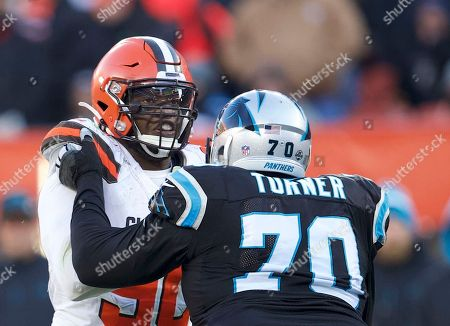 Carolina Panthers offensive guard Trai Turner (70) blocking Cleveland Browns defensive end Emmanuel Ogbah (90) at the NFL football game between the Carolina Panthers and the Cleveland Browns at First Energy Stadium in Cleveland, Ohio