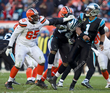 Cleveland Browns defensive tackle Larry Ogunjobi (65) push Carolina Panthers offensive tackle Chris Clark (74) into quarterback Cam Newton (1) at the NFL football game between the Carolina Panthers and the Cleveland Browns at First Energy Stadium in Cleveland, Ohio