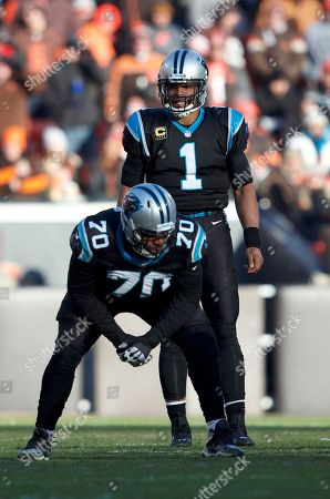 Carolina Panthers quarterback Cam Newton (1) looks over the defense behind offensive guard Trai Turner (70) at the NFL football game between the Carolina Panthers and the Cleveland Browns at First Energy Stadium in Cleveland, Ohio