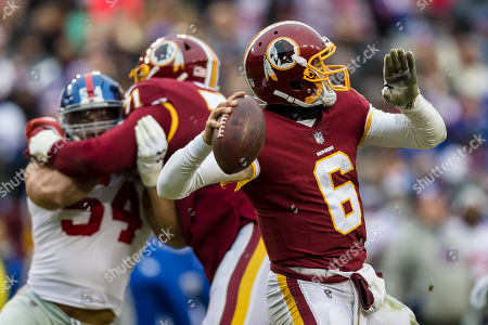 Washington Redskins quarterback Mark Sanchez (6) attempts a pass during the first half of the NFL game between the New York Giants and the Washington Redskins at FedExField in Landover, Maryland