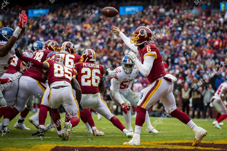 Washington Redskins quarterback Mark Sanchez (6) throws an interception that is returned for a touchdown during the first half of the NFL game between the New York Giants and the Washington Redskins at FedExField in Landover, Maryland