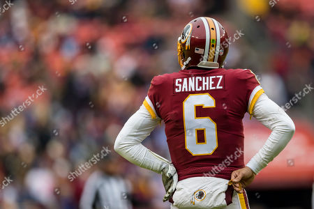 Washington Redskins quarterback Mark Sanchez (6) looks on during the first half of the NFL game between the New York Giants and the Washington Redskins at FedExField in Landover, Maryland