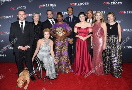 Chris Stout, Florance Phillips, Amanda Boxtel, Luke Mickelson, Abisoye Ajayi-Akinfolarin, Rob Gore, Maria Rose Belding, Ricardo Pun-Chong, Susan Munsey, Ellen Stackable. 2018 top ten CNN Heroes, from left, Chris Stout, Florance Phillips, Amanda Boxtel, Luke Mickelson, Abisoye Ajayi-Akinfolarin, Dr. Rob Gore, Maria Rose Belding, Dr. Ricardo Pun-Chong, Susan Munsey and Ellen Stackable attends the 12th annual CNN Heroes: An All-Star Tribute at the American Museum of Natural History, in New York