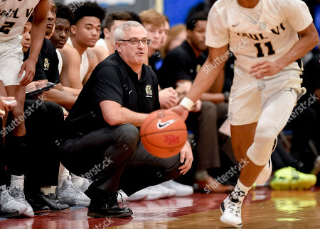 Hyattsville, Maryland, U.S. - , St. Paul head coach Glen Farello watches the action during the ARS Rescue Rooter National Hoopfest at DeMatha High School in Hyattsville, Maryland on December 9, 2018. In action between nationally ranked heavywieghts, #1 Montverde defeated #11 St. Paul VI 57-50 and #2 IMG Academy defeated #6 DeMatha 73-67 Scott Serio/Eclipse Sportswire/CSM