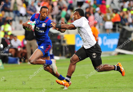 Perry Baker (L) of USA pulls away from Jerry Tuwai of Fiji during the 2018 HSBC Cape Town Sevens rugby tournament final match betwenn Fiji and the USA, in Cape Town, South Africa, 09 December 2018.