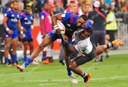 Stock Image of Perry Baker (L) of USA is tacled by Jerry Tuwai of Fiji during the 2018 HSBC Cape Town Sevens rugby tournament final match betwenn Fiji and the USA, in Cape Town, South Africa, 09 December 2018.