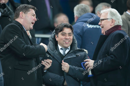 Football agent Kia Joorabchian centre smiles as he speaks with Everton former chairman Bill Kenwright right