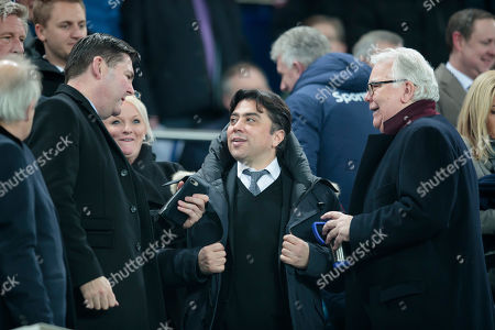 Football agent Kia Joorabchian centre speaks with Everton former chairman Bill Kenwright right