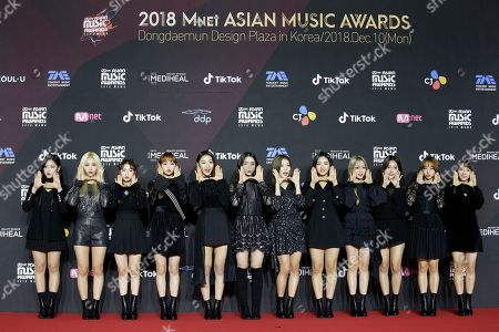 Stock Photo of Members of South Korean girl group Loona pose as they arrives on the red carpet of the 2018 Mnet Asian Music Awards (MAMA) in Seoul, South Korea