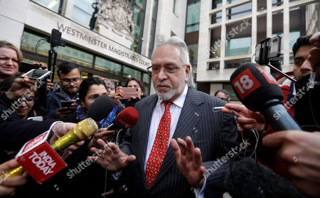 Indian businessman Vijay Mallya is surrounded by the media as he leaves Westminster Magistrates Court in London, . A British court has ordered that charismatic Indian tycoon Vijay Mallya should face extradition to India on financial fraud allegations