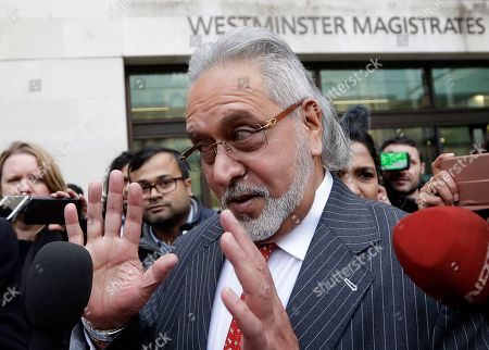 Indian businessman Vijay Mallya speaks to the media as he leaves Westminster Magistrates Court in London, . A British court has ordered that charismatic Indian tycoon Vijay Mallya should face extradition to India on financial fraud allegations