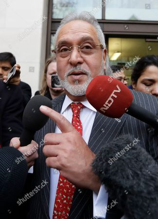 Indian business man Vijay Mallya speaks to the media as he leaves Westminster Magistrates Court in London, . A British court has ordered that charismatic Indian tycoon Vijay Mallya should face extradition to India on financial fraud allegations