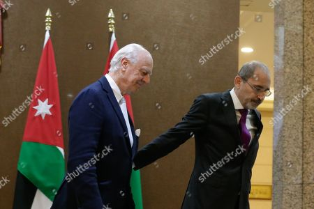 Outgoing United Nations envoy for Syria Staffan De Mistura leaves with Jordan Foreign Minister Ayman Safadi (R), after giving a statement at the Foreign Ministry in Amman, Jordan, 10 December 2018. De Mistura announced in October he would step down at the end of November from his post as Special Envoy for Syria.