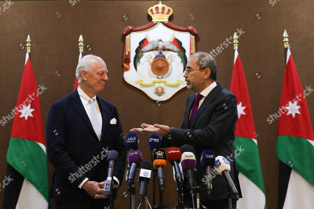Outgoing United Nations envoy for Syria Staffan De Mistura (L) listens to the Jordan Foreign Minister Ayman Safadi (R), during a statement at the Foreign Ministry in Amman, Jordan, 10 December 2018. De Mistura announced in October he would step down at the end of November from his post as Special Envoy for Syria.