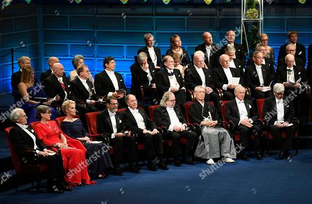(L-R first row) Nobel 2018 Prize laureates: Physics: Gerard Mourou and Donna Strickland, Chemistry: Frances H. Arnold, George P. Smith and sir Gregory P. Winter, Medicine: James P. Allison and Tasuko Honjo, and Economic Sciences William D. Nordhaus and Paul M. Romer attend the Nobel Prize 2018 Award Ceremony at the Concert Hall in Stockholm, Sweden, 10 December 2018. The Nobel prizes for laureates in medicine, chemistry, physics are awarded on 10 December on the anniversary of Alfred Nobel's death in 1896. There will be no prize awarded in literature this year.