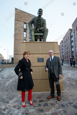 Scotlands First Minister and SNP Leader Nicola Sturgeon speaks alongside artist Andy Scott (R) at the unveiling of the Charles Rennie Mackintosh statue in Glasgow, Scotland, 10 December 2018. The work by Andy Scott is believed to be the world's first public sculpture celebrating Scottish architect, designer, and artist. Mackintosh and will be unveiled on the 90th anniversary of his death. Reports state that Nicola Sturgeon has called on Jeremy Corbyn to lodge a motion of no confidence in the Prime Minister after the British Priome Minister Theresa May's Meaningful Vote on her Brexit deal was shelved.